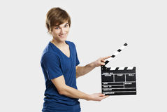 Holding a clapboard Royalty Free Stock Photography