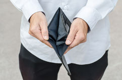 Holding a closeup to an empty wallet. No money Stock Photo