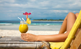 Holding a cocktail on a tropical beach Stock Photos