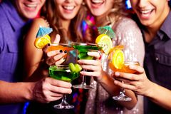 Holding cocktails Royalty Free Stock Photos
