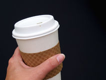 Holding coffee cup Royalty Free Stock Photo