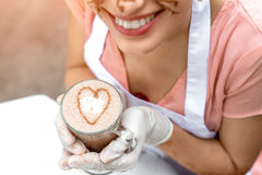 Holding coffee with heart shape Stock Photography