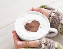 Holding Coffee Latte with Cozy Wool Hand Warmers Royalty Free Stock Photos