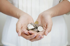 Holding coins Stock Photography