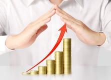 Holding coins graph stock market Stock Photos