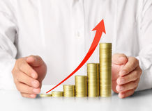 Holding coins graph stock market Royalty Free Stock Images