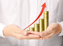 Holding coins graph stock market Royalty Free Stock Photography