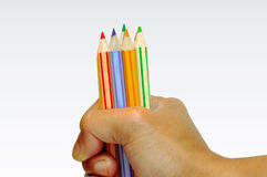 Holding color pencil Stock Image
