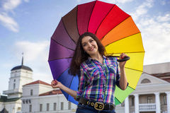 She is holding a colorful umbrella Stock Photo
