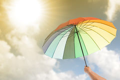 Holding colorful umbrella Royalty Free Stock Photography
