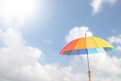 Holding colorful umbrella Royalty Free Stock Photos