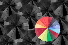 Holding colorful umbrella for saving money. Royalty Free Stock Photography