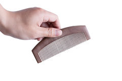 Holding comb isolated on white Royalty Free Stock Photos