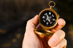 Holding a compass Royalty Free Stock Images