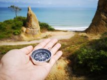 Holding on a compass showing your direction and your navigation by facing to the ocean. A compass is an instrument used for navigation and orientation that shows royalty free stock photos