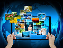 Holding Computer display  on technology background Royalty Free Stock Images