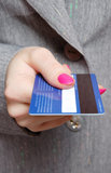 Holding a credit card Royalty Free Stock Image