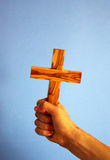 Holding cross Stock Image