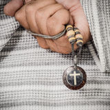 Holding a cross necklace. Stock Images