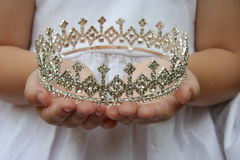 Holding crown Royalty Free Stock Image