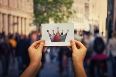 Holding crown symbol stock photography