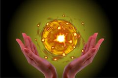 Holding the Crystal ball glow in my hand with black background. stock photo