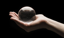 Holding a Crystal Ball Royalty Free Stock Photos