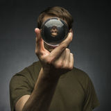 Holding a Crystal Ball Royalty Free Stock Image