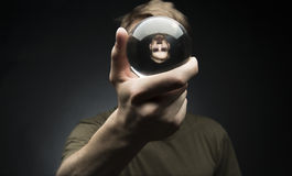 Holding a Crystal Ball Stock Photo