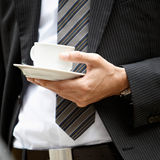 Holding a cup of coffee Stock Photos