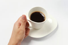 Holding a cup of coffee. Stock Photo
