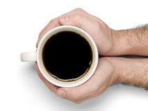 Holding a cup of coffee Royalty Free Stock Photo