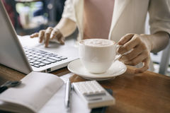 Holding a cup of coffee Royalty Free Stock Image