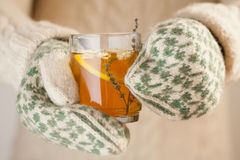 Holding a cup of tea Stock Image