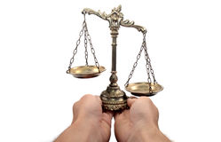 Holding Decorative Scales of Justice Royalty Free Stock Photos
