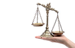 Holding Decorative Scales of Justice Stock Photos
