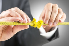 Holding defective yellow rope Royalty Free Stock Photos
