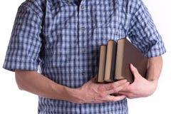 Holding degli uomini libri Fotografia Stock Libera da Diritti