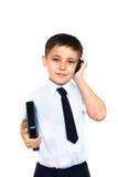 Holding del ragazzo che comunica sul telefono Fotografie Stock Libere da Diritti