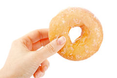 Holding a delicious donut Stock Photo