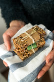 Holding delicious homemeade granola bars Royalty Free Stock Images