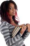 Holding dell'allievo dell'adolescente i suoi libri di studio Fotografia Stock Libera da Diritti