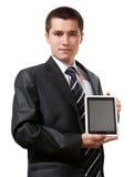 Holding dell'uomo di affari e ridurre in pani dello schermo di tocco di esposizioni fotografia stock libera da diritti