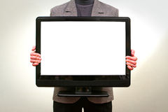Holding dell'uomo nell'affissione a cristalli liquidi TV delle mani Fotografie Stock Libere da Diritti