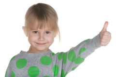 Holding della bambina il suo pollice in su Immagine Stock