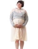 Holding della donna incinta il suo tummy Fotografia Stock