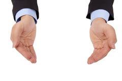 Holding della mano di s dell'uomo d'affari 'qualcosa Fotografia Stock