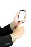 Holding della mano e telefono astuto di tocco Fotografia Stock Libera da Diritti