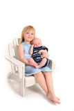 Holding della sorella il suo fratello appena nato del bambino su bianco Immagini Stock Libere da Diritti