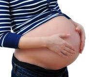 Holding der schwangeren Frau ihr Bauch Stockbilder
